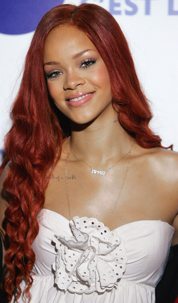 Good Girl... Rihanna looks like the girl next door with her long extensions and pleasant smile.